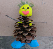 snowman from play dough and pine cone