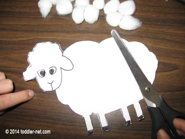cutting out a sheep shape