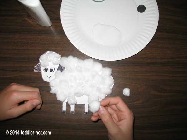 covering sheep cut out with cotton balls